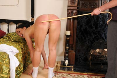 Kiki bent over and caned